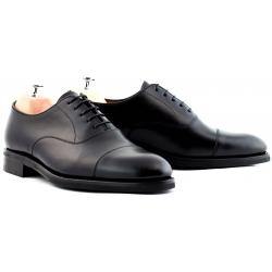 Cap toe oxford svart med halv gummisula
